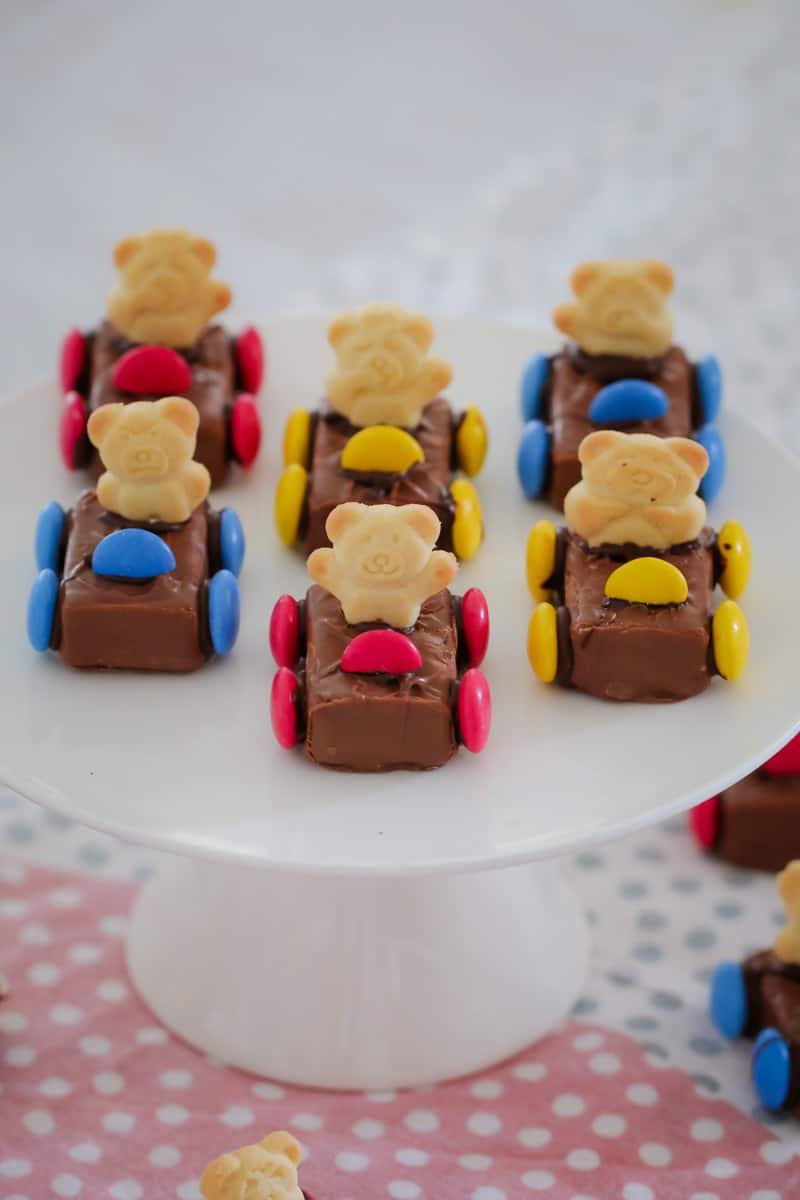 Tiny Teddy Racing Cars on a cake stand with coloured Smarties for wheels