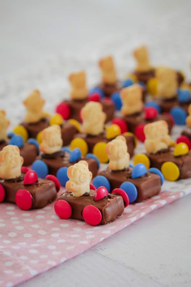 Rows of Tiny Teddy Racing Cars made from a Milky Way with smarties for wheels and a Tiny Teddy biscuit as the driver