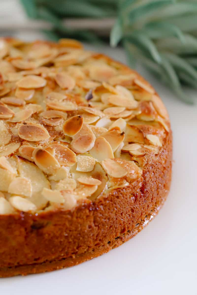 A butter cake cooked until golden with almonds and apple.