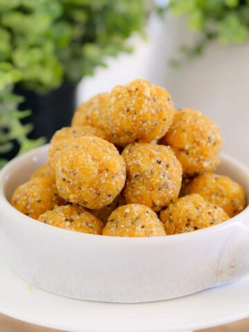 Super easy and healthy Apricot, Coconut & Chia Balls - the perfect kid-friendly lunch box snack! Just 10 minutes prep time and completely no-bake... mix, roll and eat!