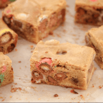 Squares of a chocolate slice with a filling of mini Easter eggs and chocolate chips