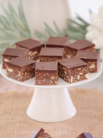 A quick and easy classic dark chocolate hedgehog slice made with crushed biscuits, walnuts, coconut and condensed milk... the perfect melt and mix slice!