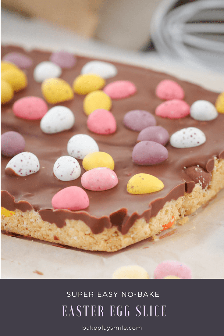 A rectangular slice, with milk chocolate topping and decorated with coloured mini Easter eggs