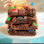 Pinterest graphic for stack of M&M brownies