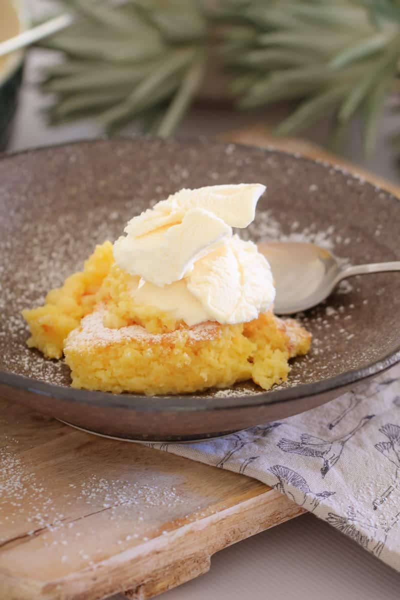 Vanilla ice-cream on a pudding.