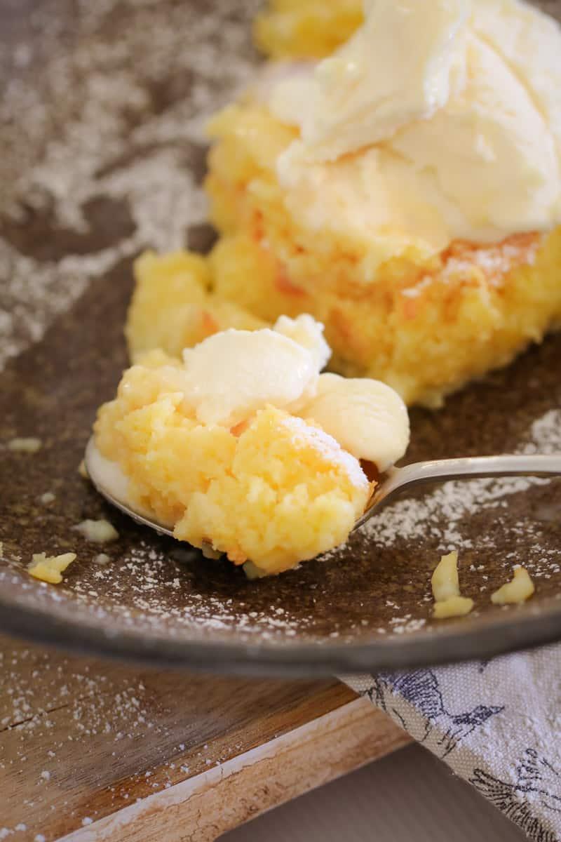 A spoon of ice-cream and lemon sponge.