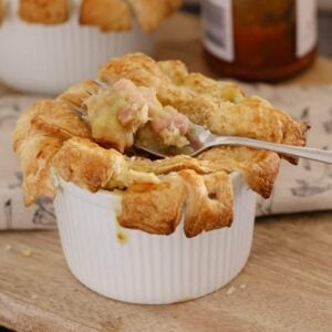 Creamy Chicken, Leek & Bacon Pies topped with crispy puff pastry are easy to make and taste delicious... a classic winter dinner. Printable conventional and Thermomix recipes included.