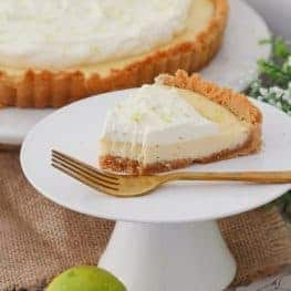 A deliciously simple Key Lime Pie made with a crushed biscuit base, a baked creamy lime filling with sweetened condensed milk and eggs, and a whipped cream topping. A quick and easy dessert the whole family will love! Printable conventional and Thermomix recipe cards included.