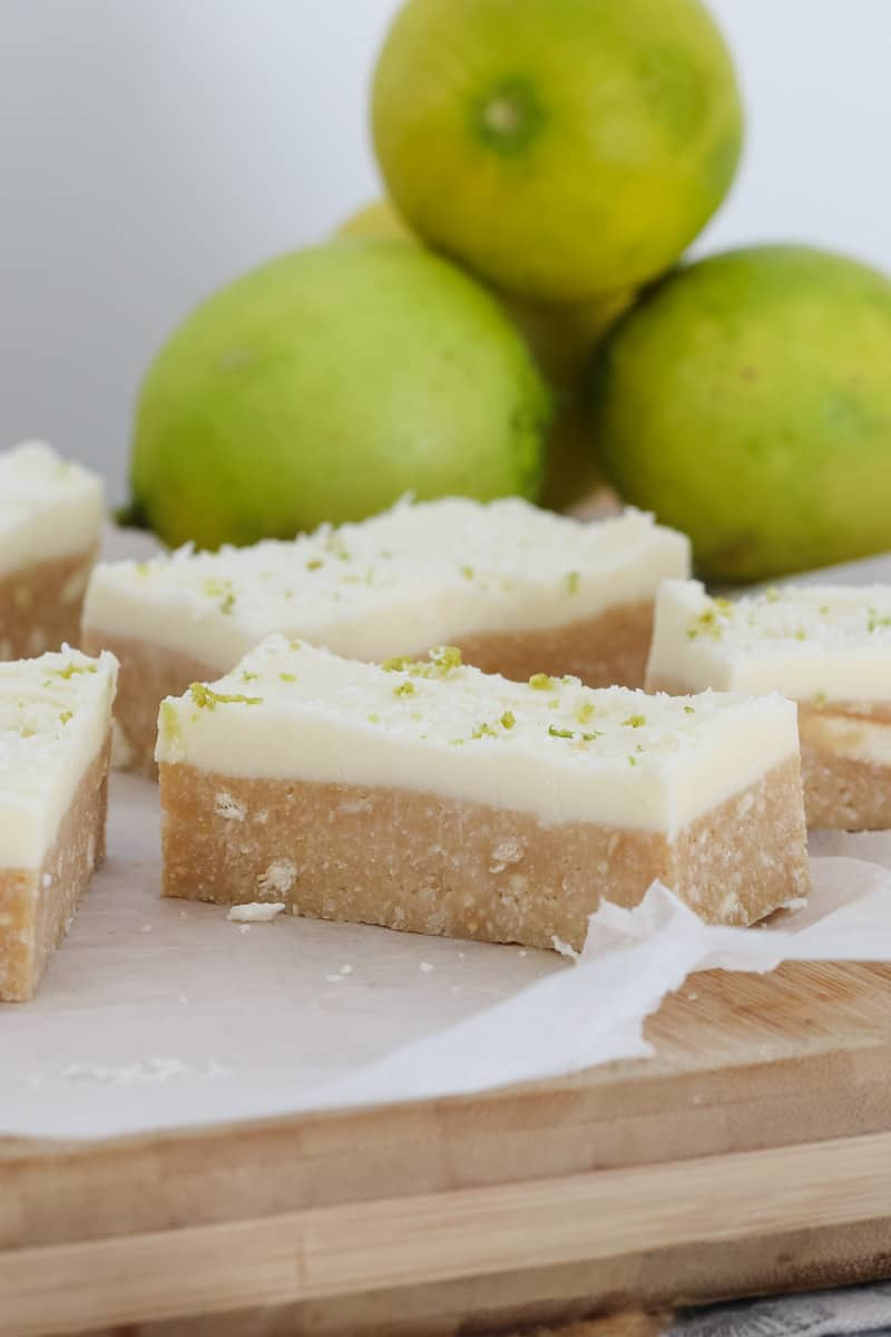 The easiest and most delicious Lime & Coconut Slice you'll ever make! Made from crushed biscuits, butter, sweetened condensed milk, coconut & lime juice with a creamy and tangy lime frosting. Conventional & Thermomix printable recipe cards included.