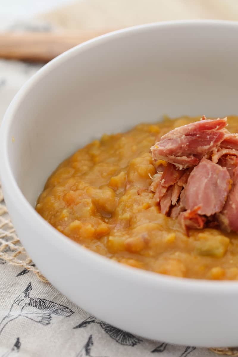 A bowl of split pea and ham hock soup.