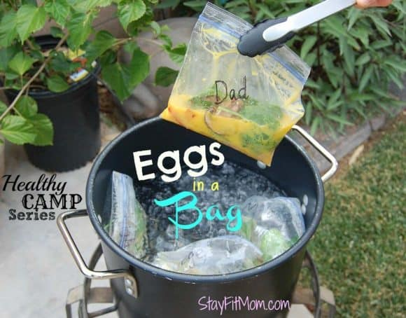 Eggs being cooked in a bag over a camp stove.