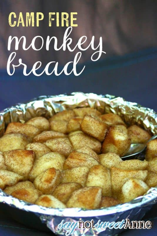 Monkey bread being cooked in a foil tray on a camping oven.