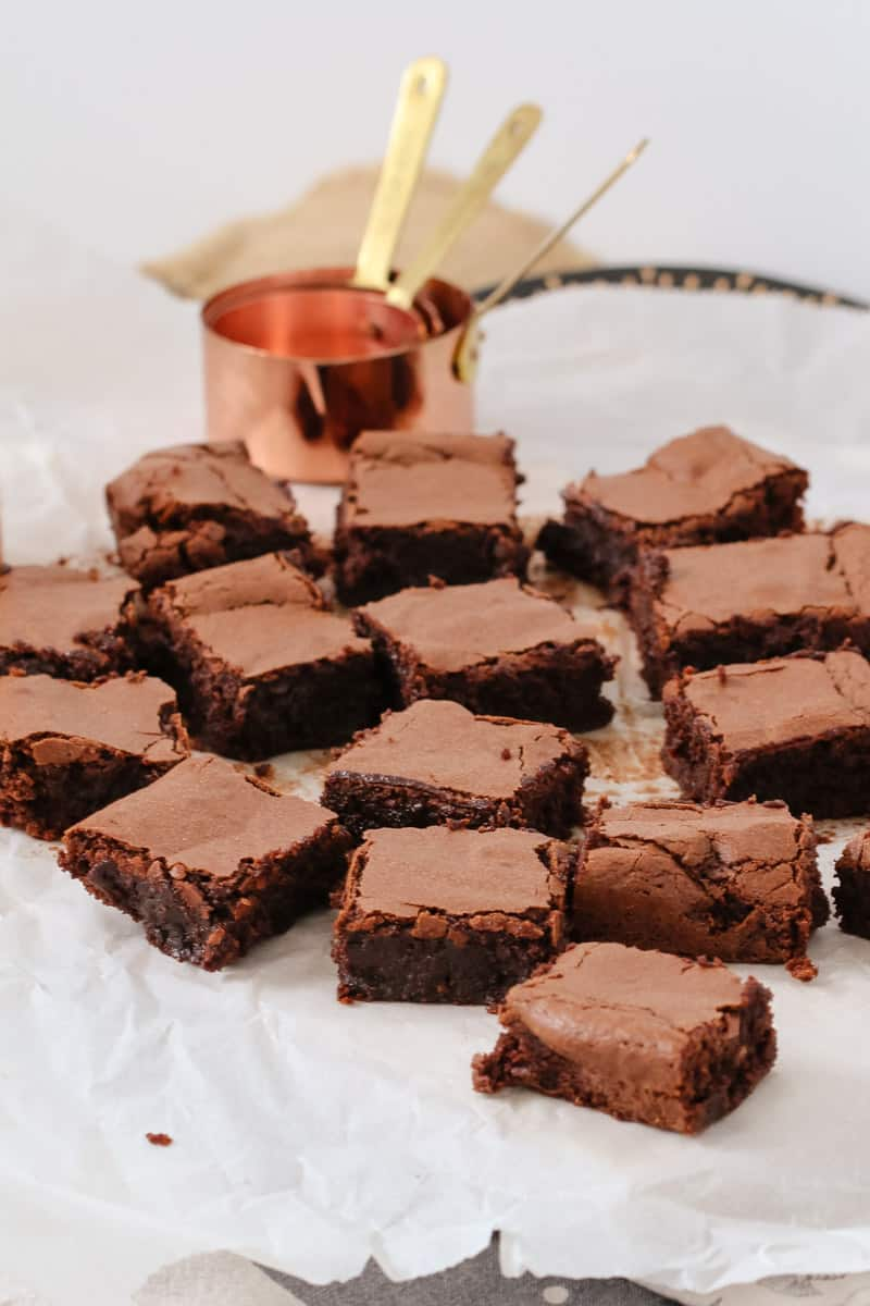 Squares of dark chocolate and almond meal chocolate brownies