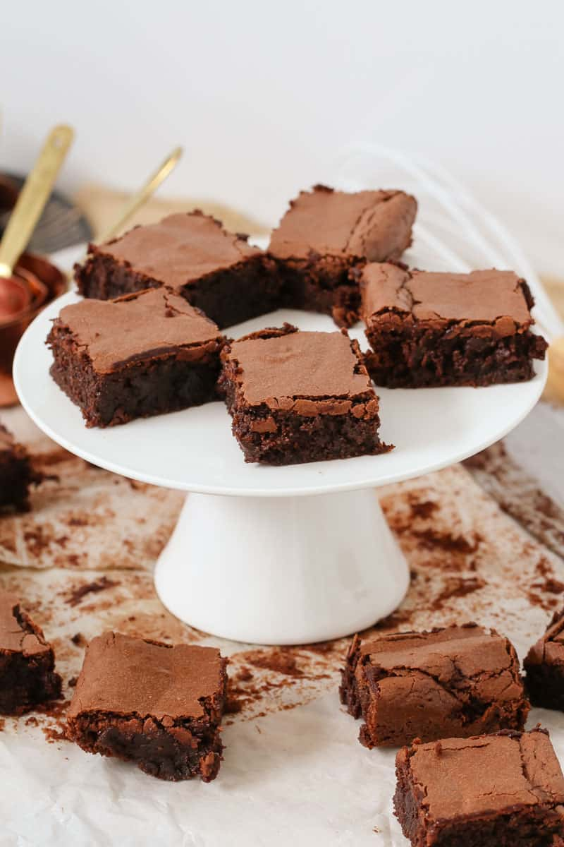 Gluten free brownies on a cake stand made from almond meal and dark chocolate