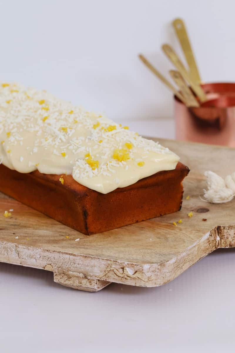 A simple and delicious Lemon Coconut Loaf made with greek yoghurt and smothered with cream cheese frosting... the perfect morning tea treat or lunch box snack. Printable conventional and Thermomix recipe cards included.