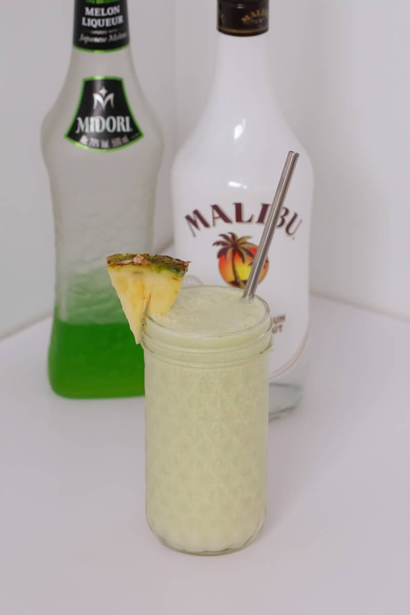 A creamy Midori Cocktail made with Midori liqueur, Bacardi rum, pineapple juice, lime juice, coconut cream and ice... the perfect summer drink!