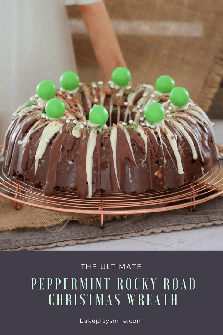A wreath shaped chocolate cake, drizzled with white and milk chocolate and topped with green lollies