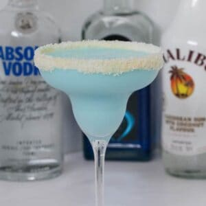 Our boozy Blue Coconut Rum Cocktail made with Malibu, Vodka, Blue Curacao, coconut water and coconut cream is deliciously refreshing!