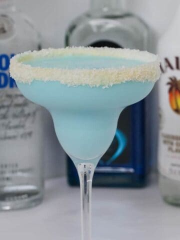 Our boozyBlue Coconut Rum Cocktail made with Malibu, Vodka, Blue Curacao, coconut water and coconut cream is deliciously refreshing!