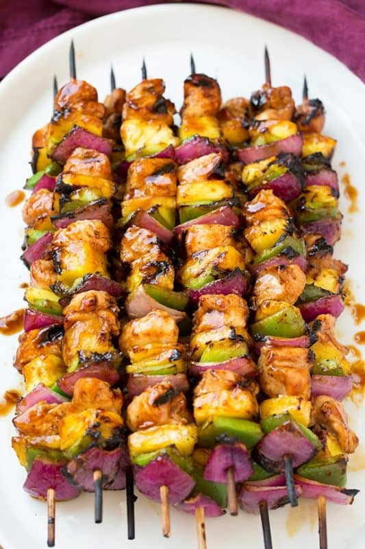 Grilled chicken skewer kebabs with red onion, capsicum and pineapple.