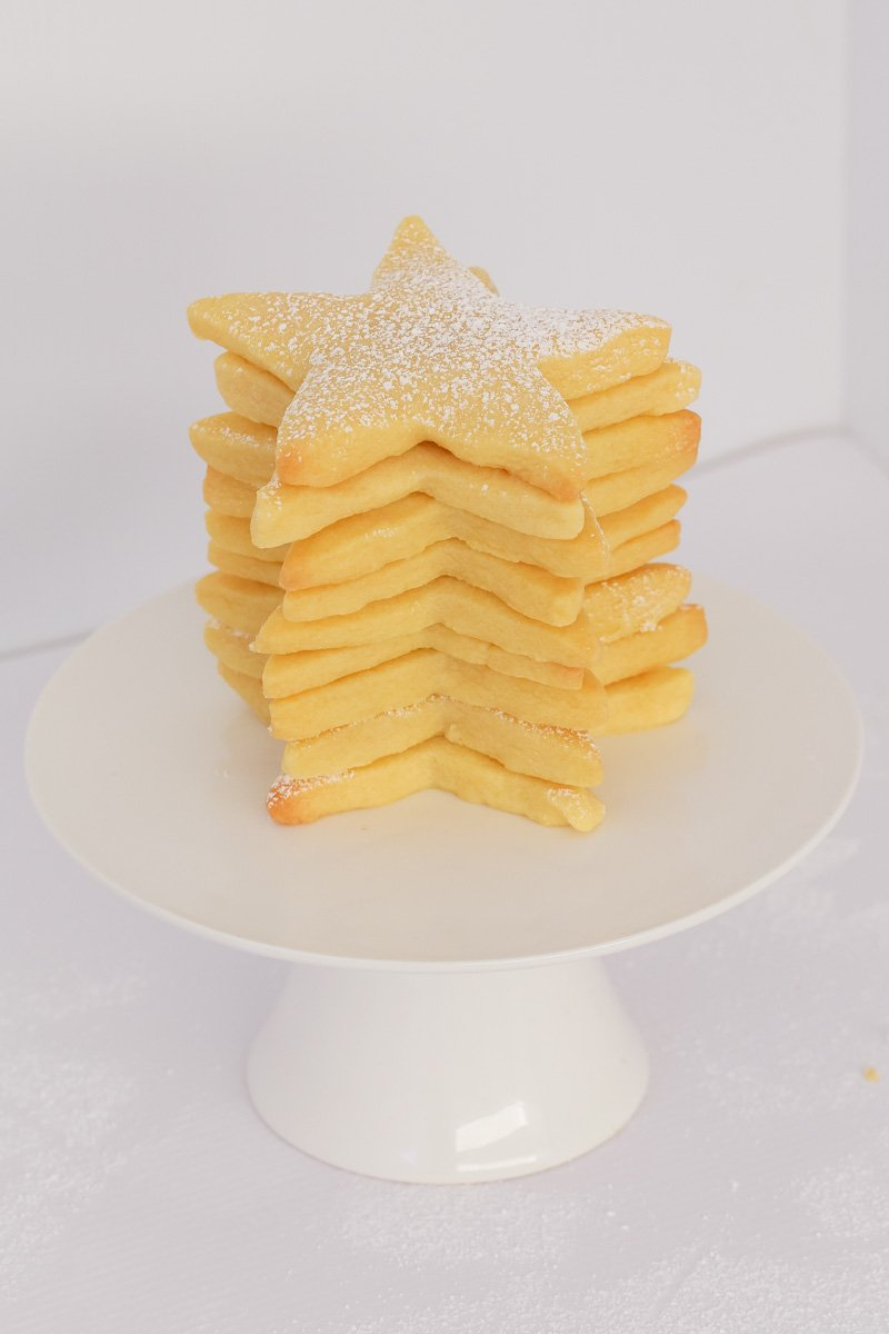A stack of star shaped Christmas shortbread cookies.