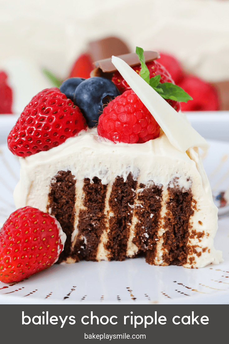 The ultimate Baileys Chocolate Ripple Cake decorated with fresh berries and chocolate... this quick and easy recipe is the perfect no-bake dessert!