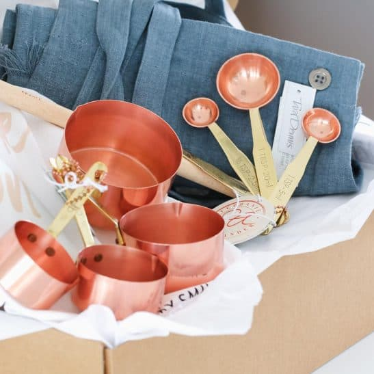 Our 'Classic Cooking Hamper' is the ultimate gift for a girl who loves to cook in style! Filled with on-trend copper measuring cups and spoons, a linen apron, beechwood spoon and our designer 'You Only Live Once. Lick The Spoon' tea towel... this is a gift that is both unique and classic.