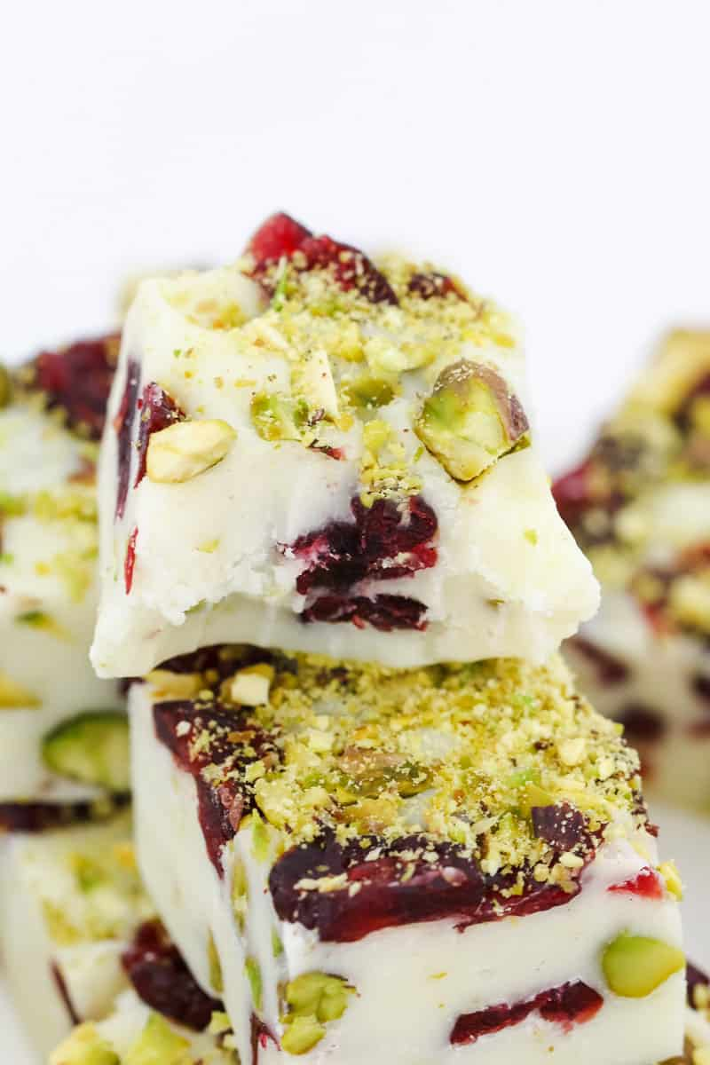 A super simple 4 ingredient microwave Christmas fudge recipe made from white chocolate, condensed milk, cranberries and pistachios... ready in less than 5 minutes!!