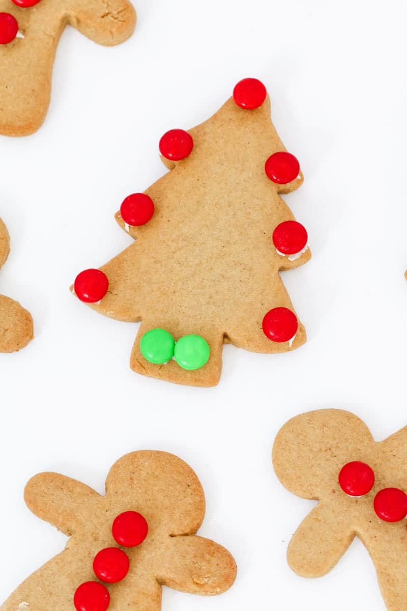 Christmas gingerbread shapes that have been decorated with green and red smarties.