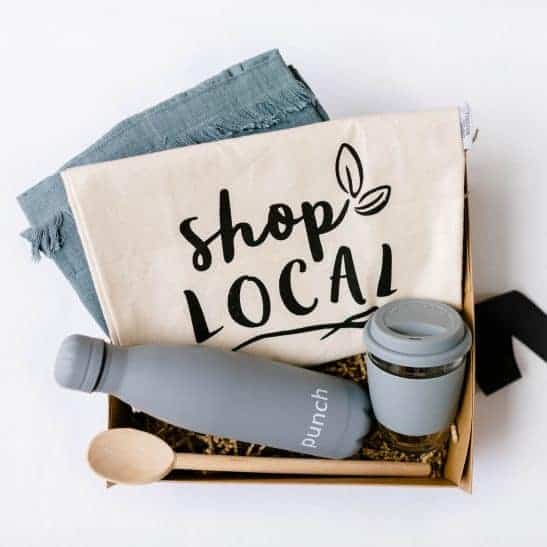 The Eco-Friendly Hamper is the perfect gift for someone passionate about sustainability and the environment. Our gorgeous hampers are filled with items aimed to reduce waste, including a reusable grocery tote, linen apron, classic wooden spoon, stainless steel drink bottle and eco cup. Available in pink or grey.