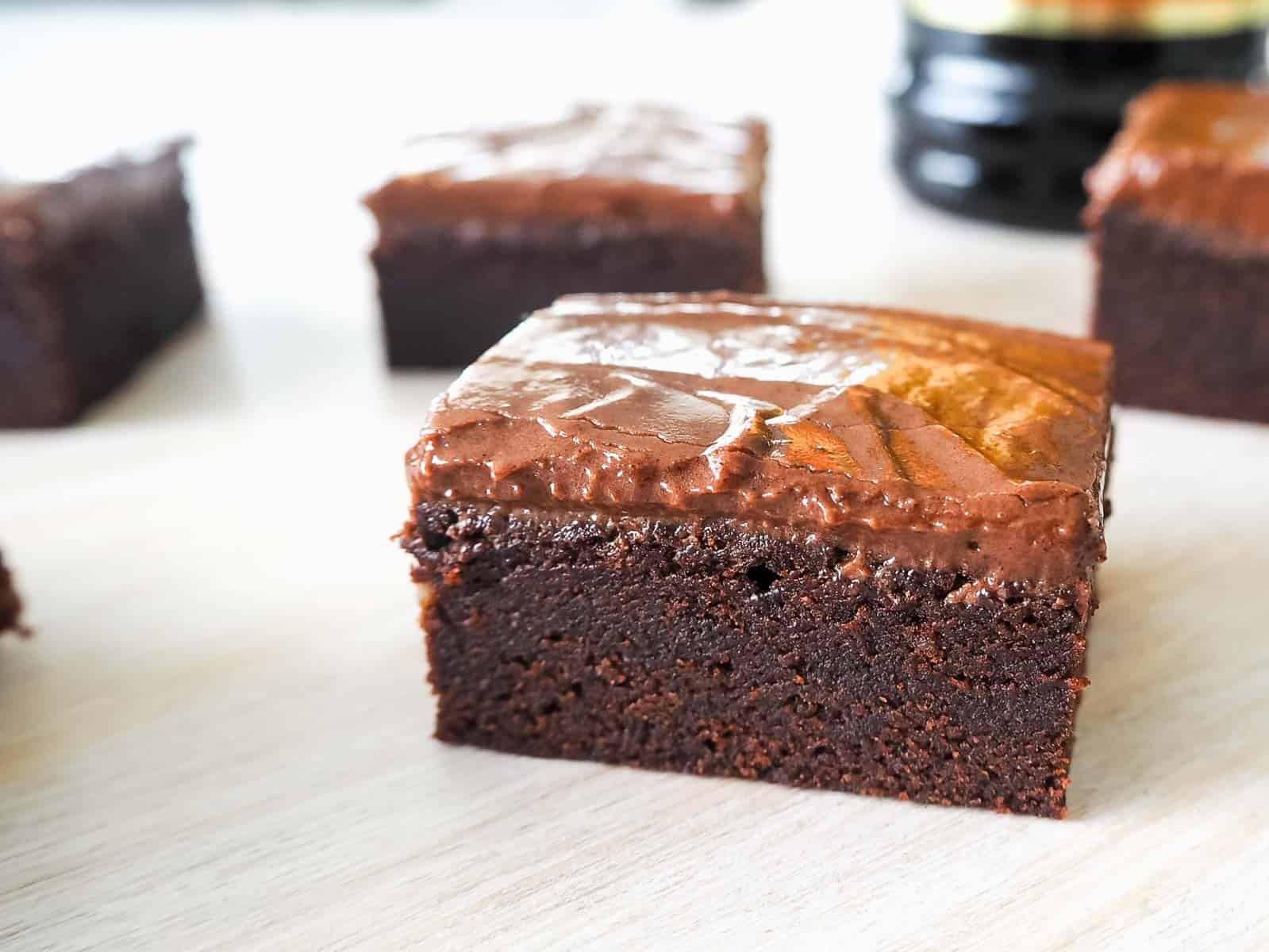 Pieces of chocolate brownie slice with a chocolate ganache