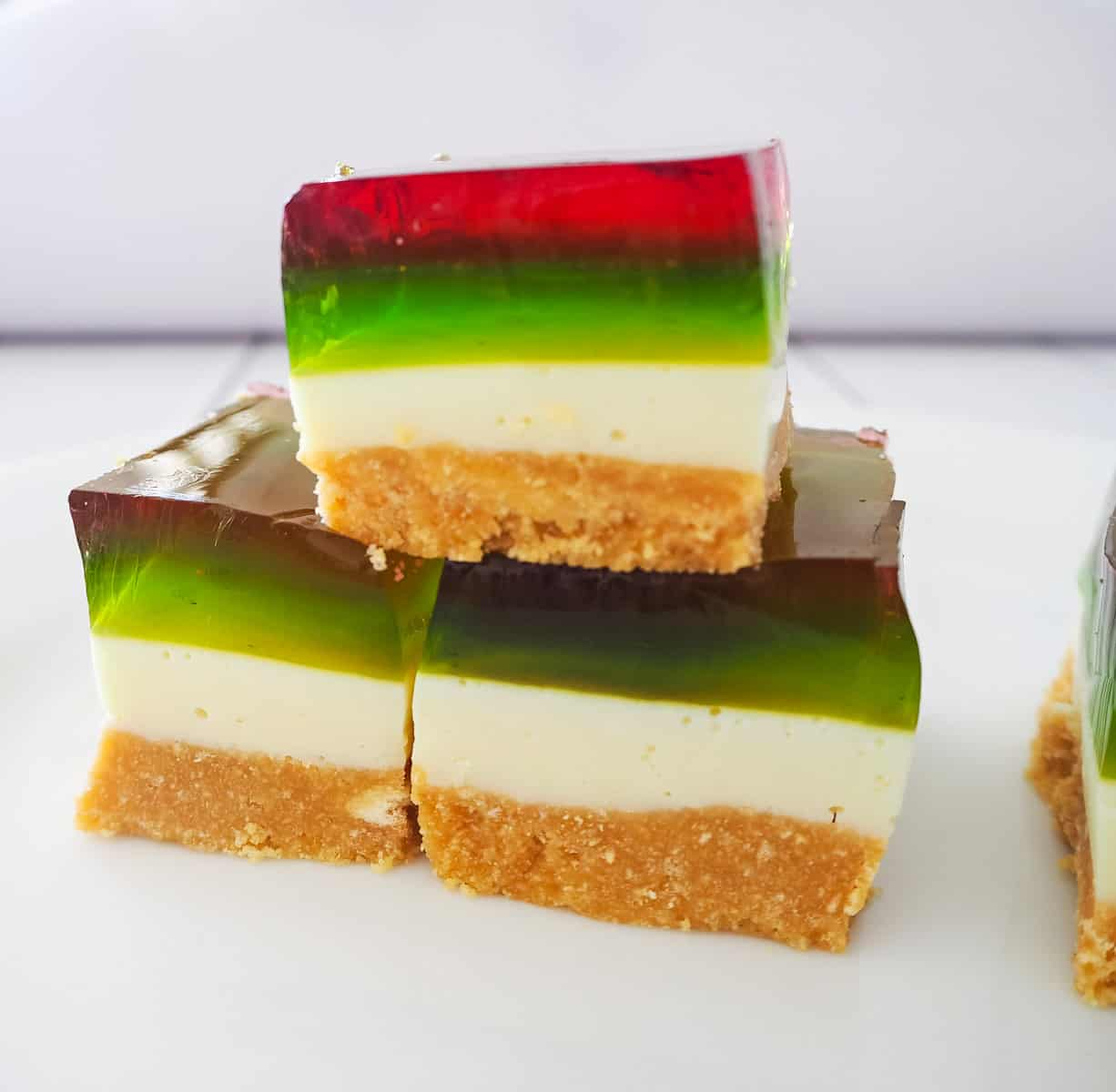 Three pieces of red, green and white layered jelly slice