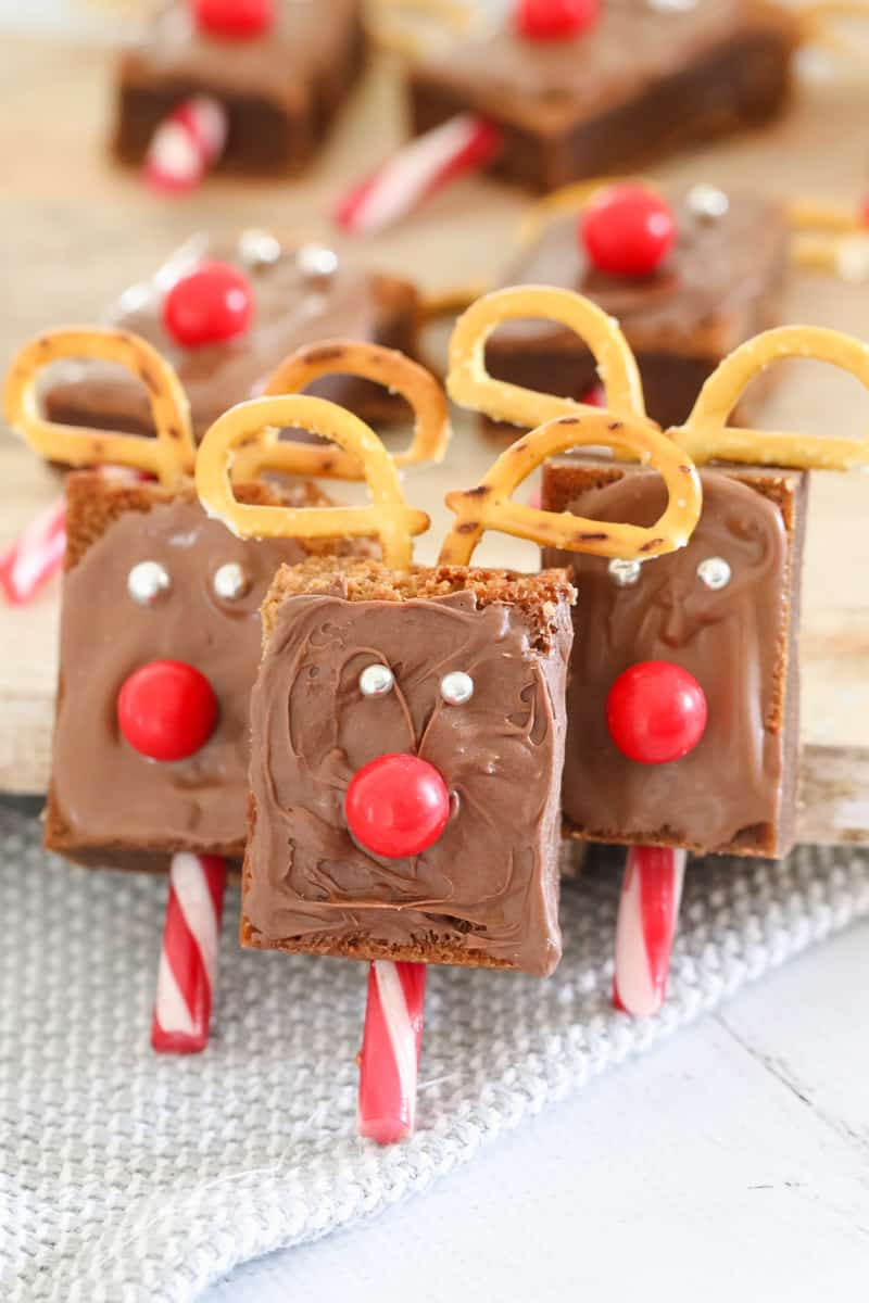 Chocolate coated reindeer faces on candy sticks with pretzels for antlers