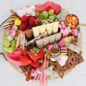 Packed with chocolates, lollies and fruit, this dessert grazing platter is the ultimate for entertaining... and it only takes 10 minutes to make!