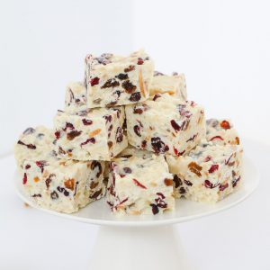 A simple White Christmas Slice recipe made with white chocolate, rice bubbles, dried cranberries, sultanas, coconut and almonds.