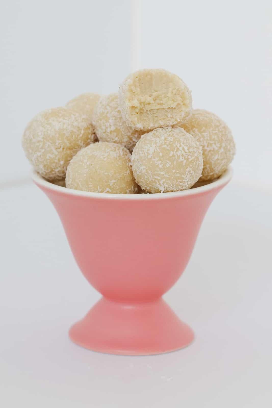 A half eaten dessert ball made with Tim Tam biscuits.