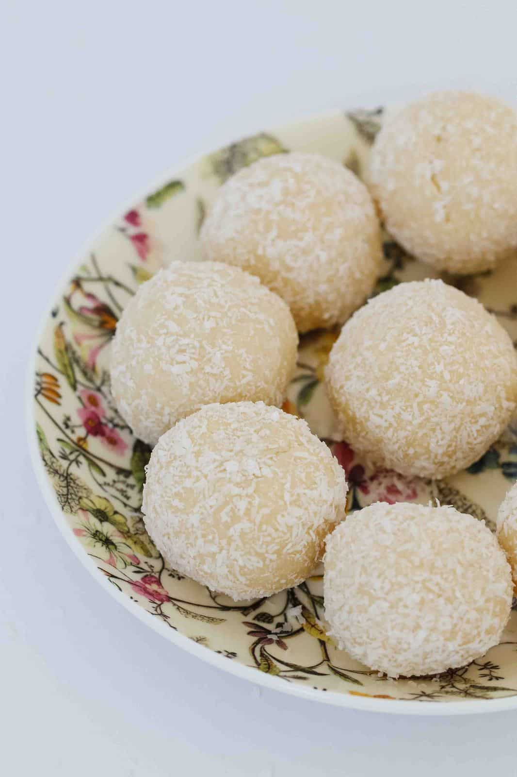 White chocolate balls on a serving plate.