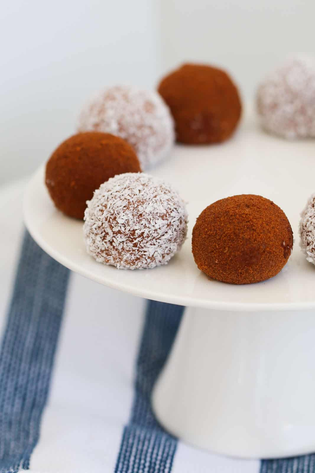 Sweetened condensed milk and Tim Tam balls on a plate.