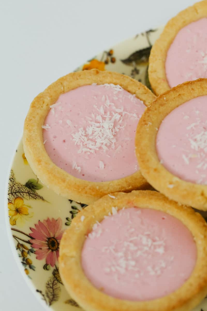 Coconut and marshmallow in jam filled pastry tarts.