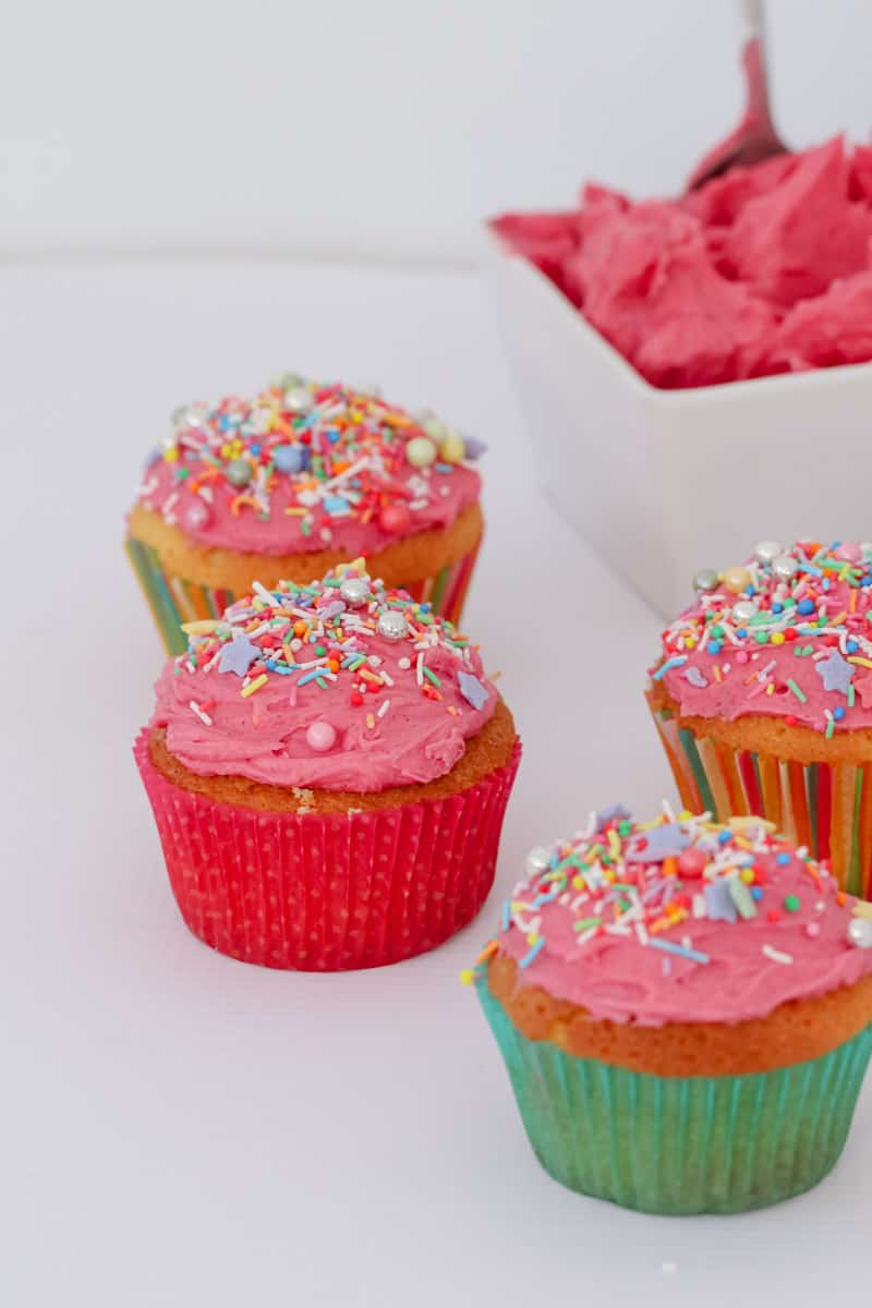 Kids party cupcakes with pink buttercream frosting.