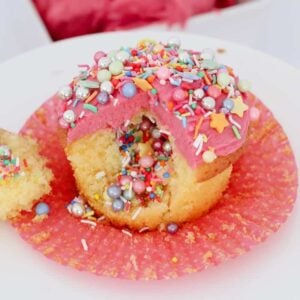 Kids party cupcakes with a surprise filling of sprinkles.