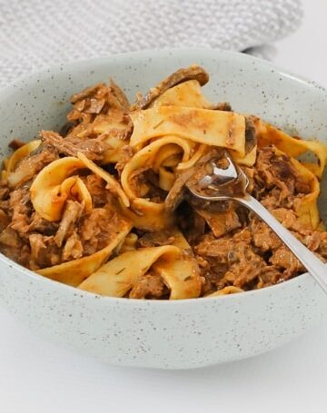 A family favourite slow cooker beef stroganoff recipe filled with tender beef in a creamy mushroom sauce and served with pasta.