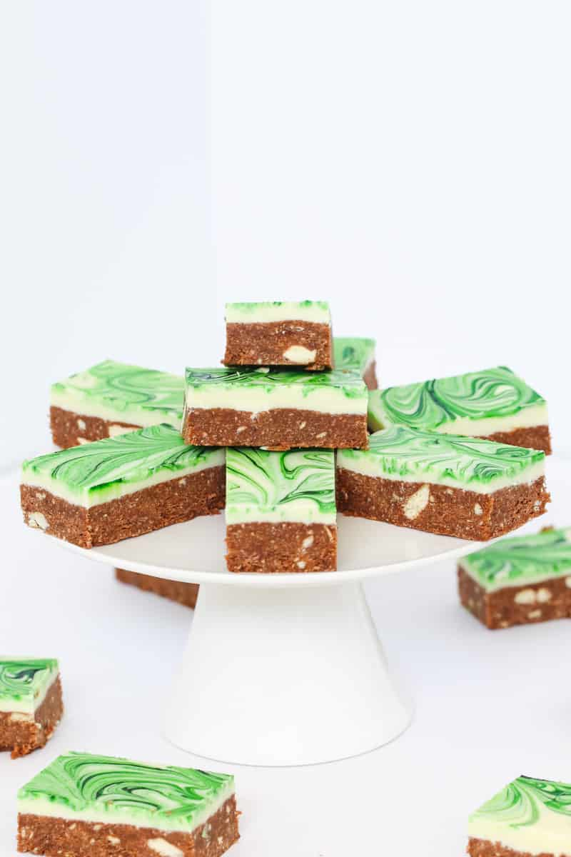 A plate of pieces of peppermint slice with a chocolate biscuit base and white chocolate layer.