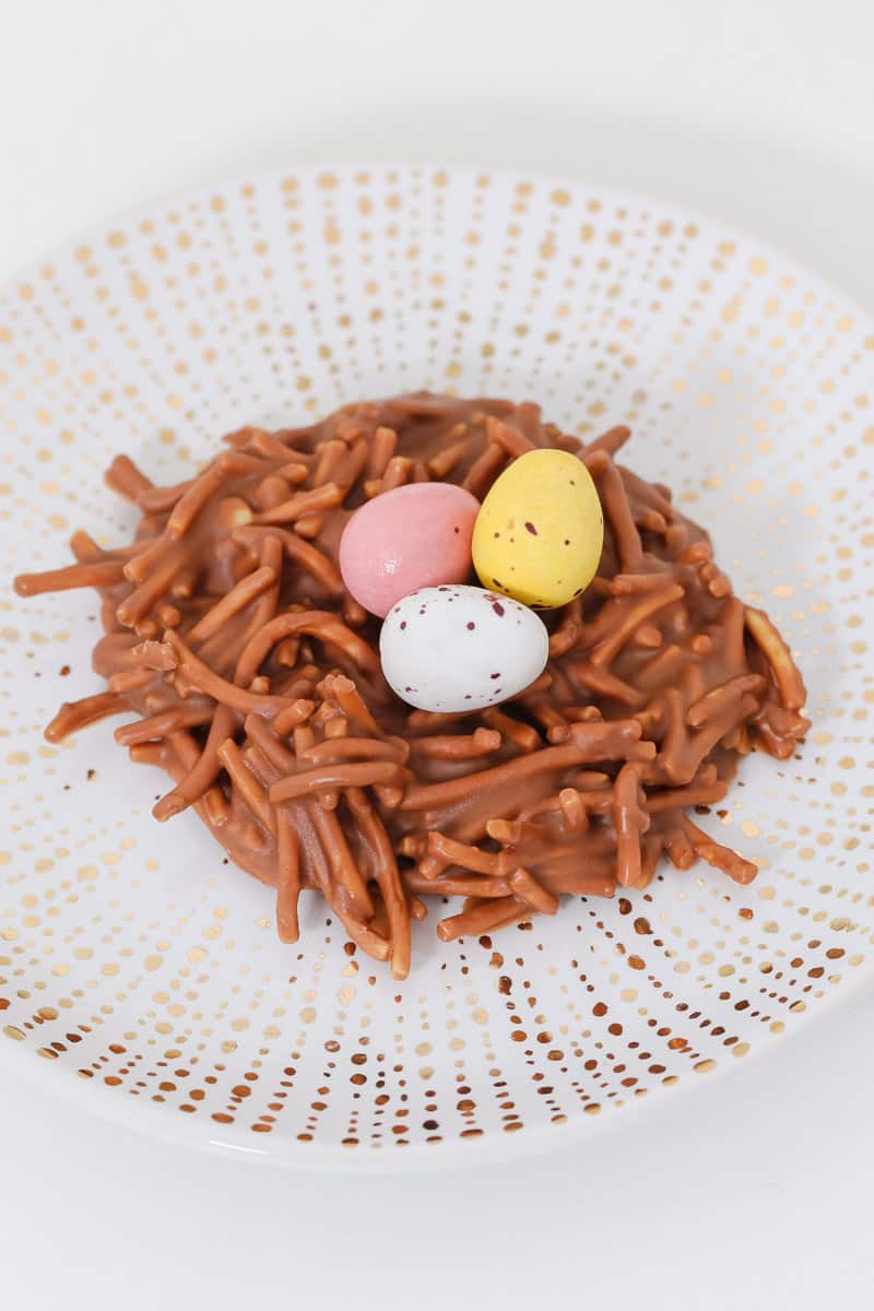 Mini easter eggs on a chocolate noodle birds nest.