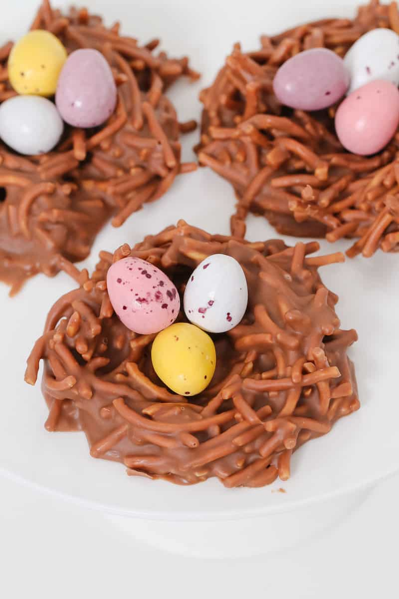 Chocolate birds nests made from fried noodles, melted chocolate, peanut butter and easter eggs.