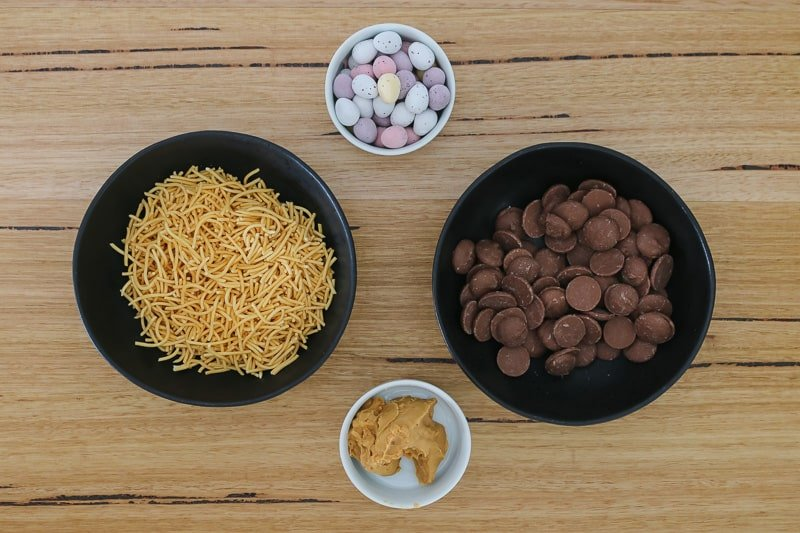 Bowls of fried noodles, chocolate, easter eggs and peanut butter.
