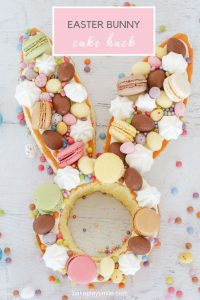 A super cute Easter bunny cake hack made from store-bought unfilled sponge cakes, frosting, macarons, Easter eggs, mini meringues & more!