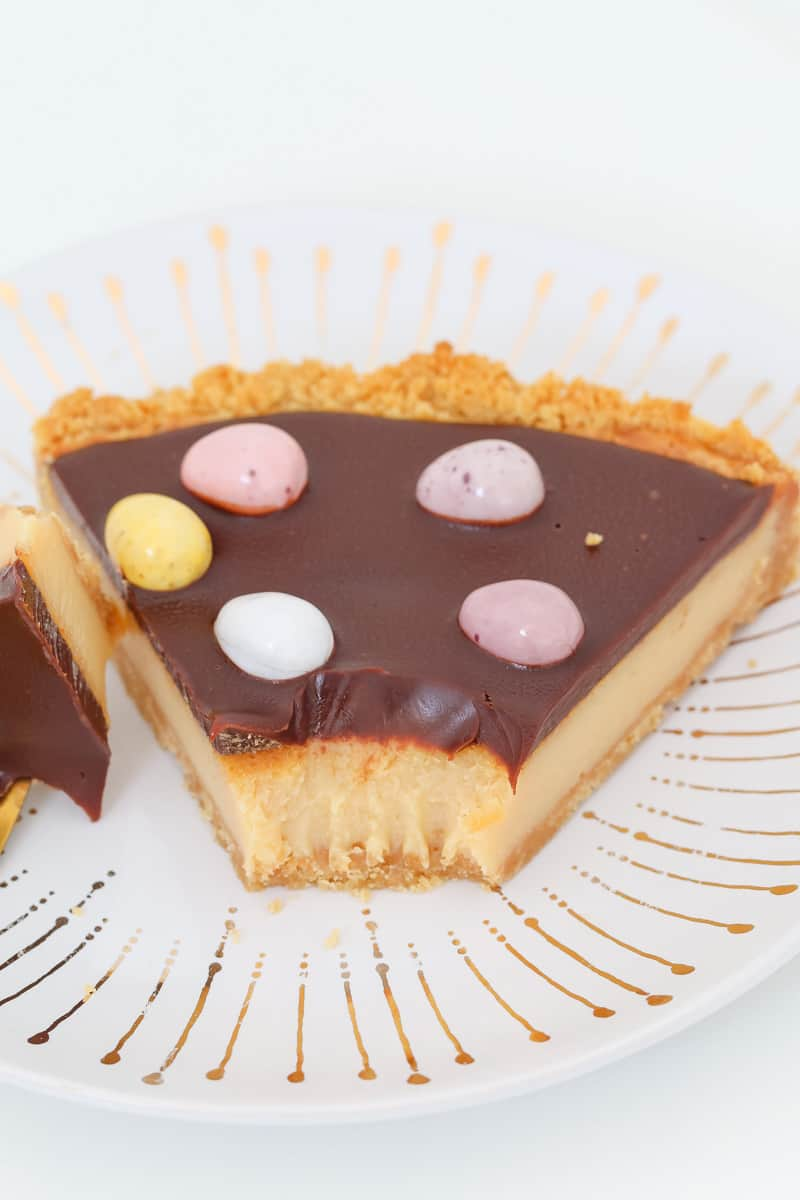 A caramel chocolate tart with a crushed biscuit base.