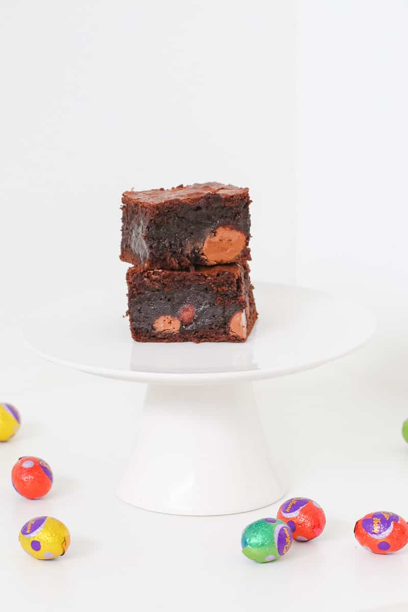 Two pieces of rich, moist chocolate brownie filled with Easter eggs.