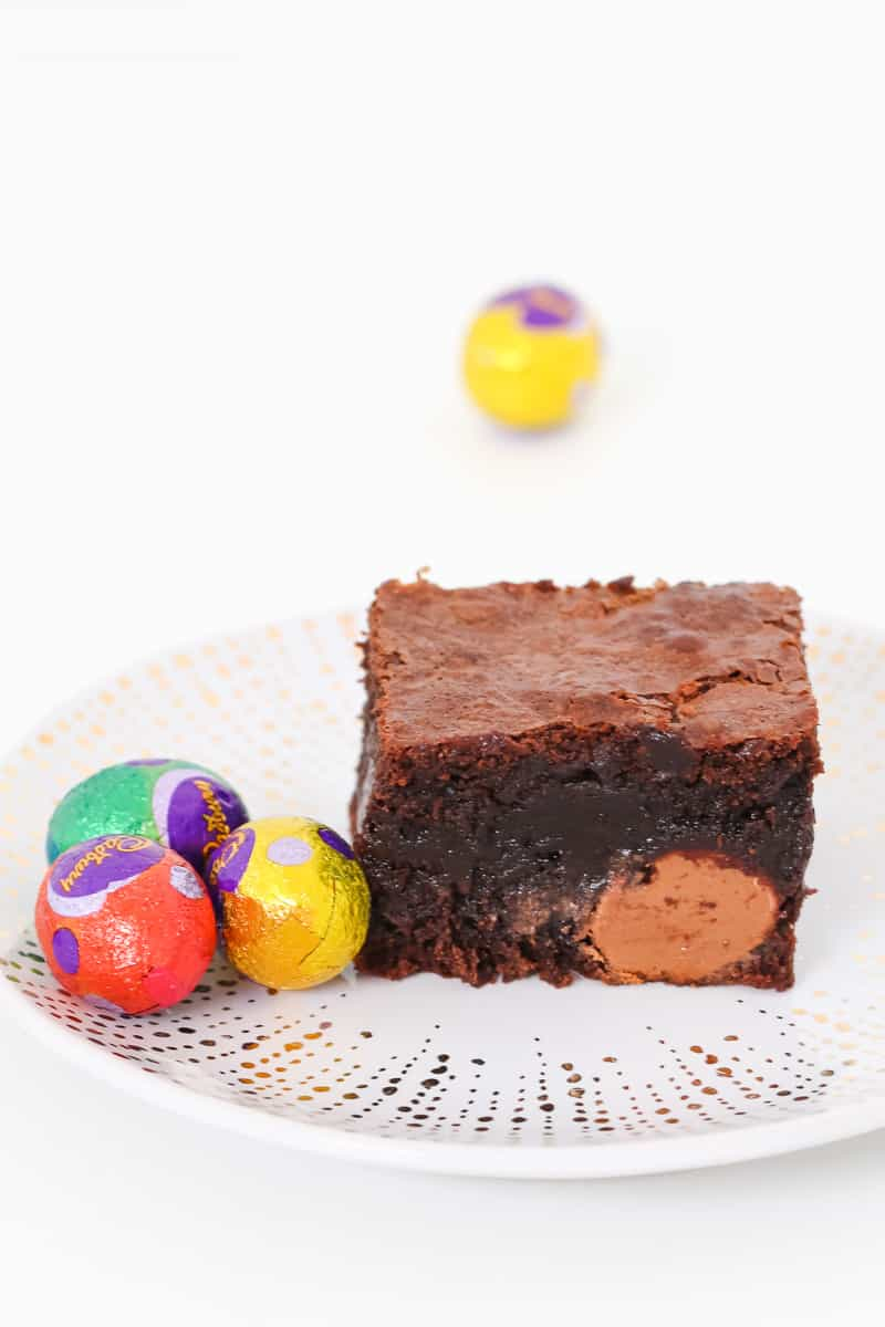 Cadbury mini solid Easter eggs inside a dense piece of rich chocolate brownie.